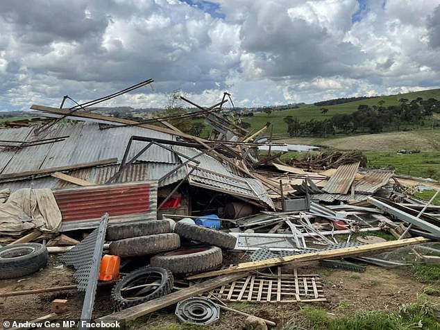Three people were injured by the wild tornado that tore through the small town west of Sydney and damaged houses, powerlines and trees (pictured, damage to Mr McKinnon's home)