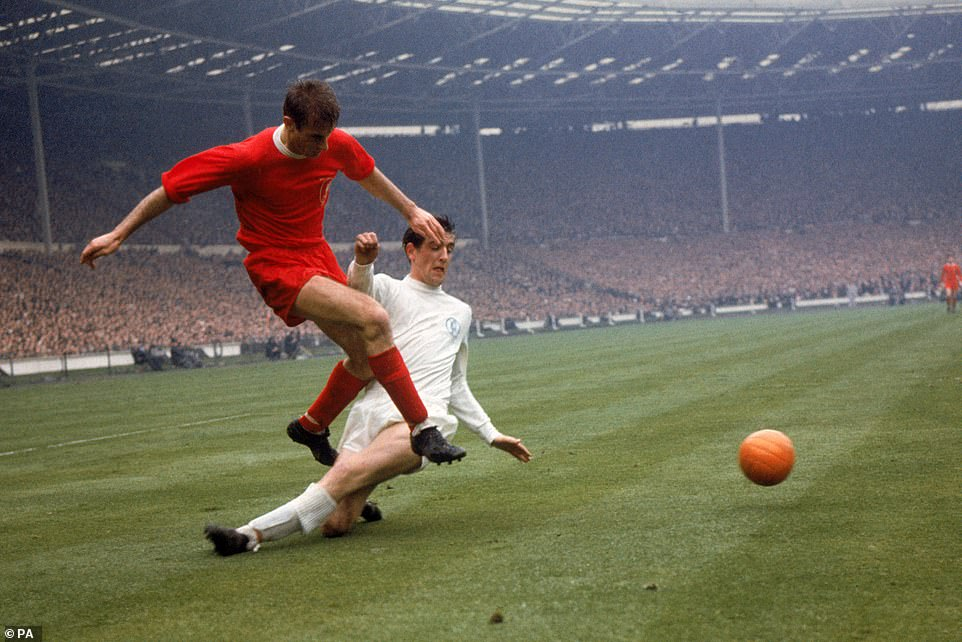 Norman Hunter of Leeds United times his reducer too late to prevent Hunt crossing in the 1965 FA Cup final at Wembley. Hunt scored Liverpool's opening goal early in extra time