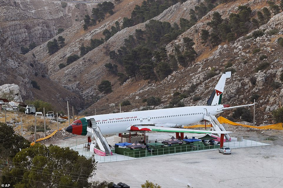 Twin brothers in the occupied West Bank have converted an old Boeing 707, pictured, into a cafe and restaurant
