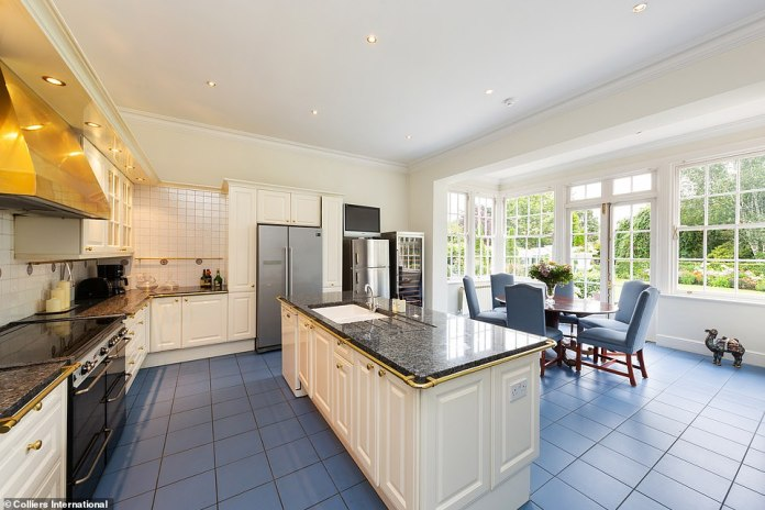The new owners can cook in the home's 'English style' kitchen with an adjoining pantry, pictured above