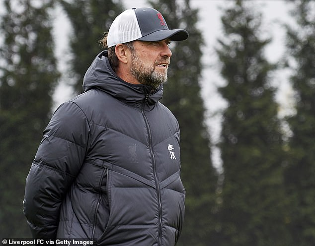 Jurgen Klopp's side are deciding whether the pair should quarantine in Spain before they play Atletico Madrid next week