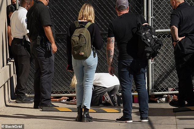 Security: As she crouched to the floor Billie was surrounded by security and members of her team