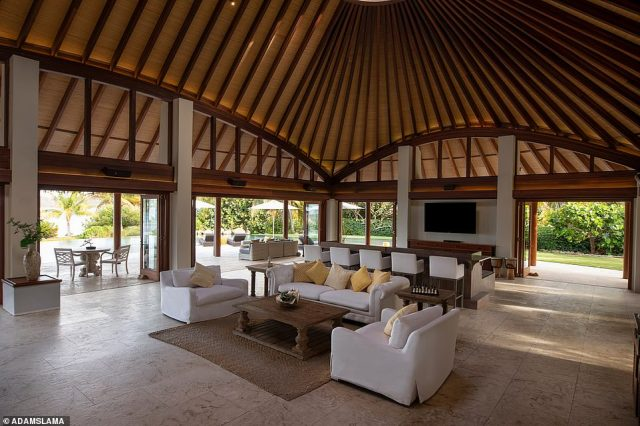 The Beach Villa, pictured above, has four bedrooms and its own private infinity pool