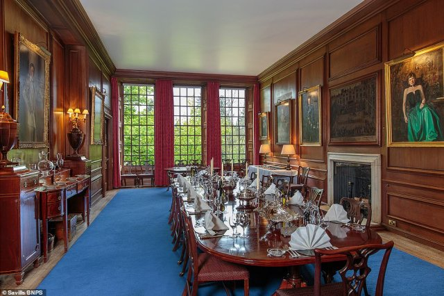 The castle's main dining room, which seats 20, dates to the early 1900s but is fitted in a late 17th century style with panelled walls