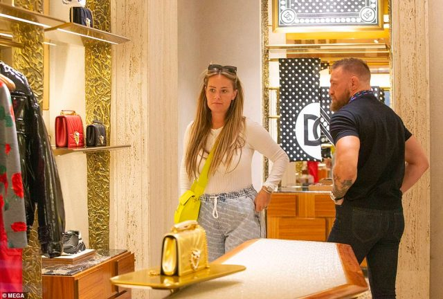 Luxury items: The couple had a good look around the Dolce and Gabbana store before heading back out to the street