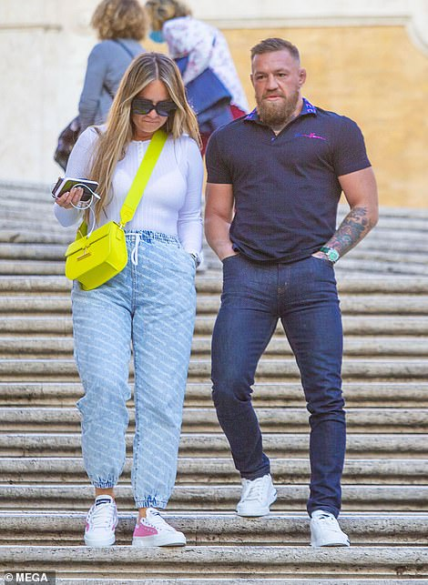 Looking good:Dee looked stylish in a white jumper and carried a neon green bag with her