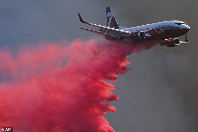 Firefighters working in steep, rugged terrain got help from more than a dozen water-dropping air tankers (pictured on Wednesday) that returned to the skies amid calmer daytime winds