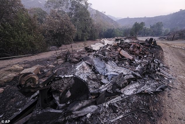 A burnt-out boat is pictured in Goleta, California after a wildfire on Wednesday