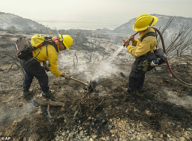 County of Santa Barbara Fire Departement firefighters extinguish a roadside fire off off the U.S. 101 Highway inGoleta on Wednesday