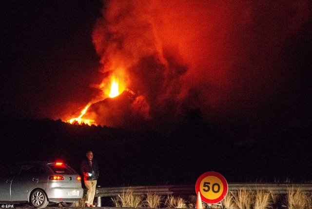 The volcano is seen in the early hours of Wednesday - the 24th day since eruptions began at Cumbre Vieja
