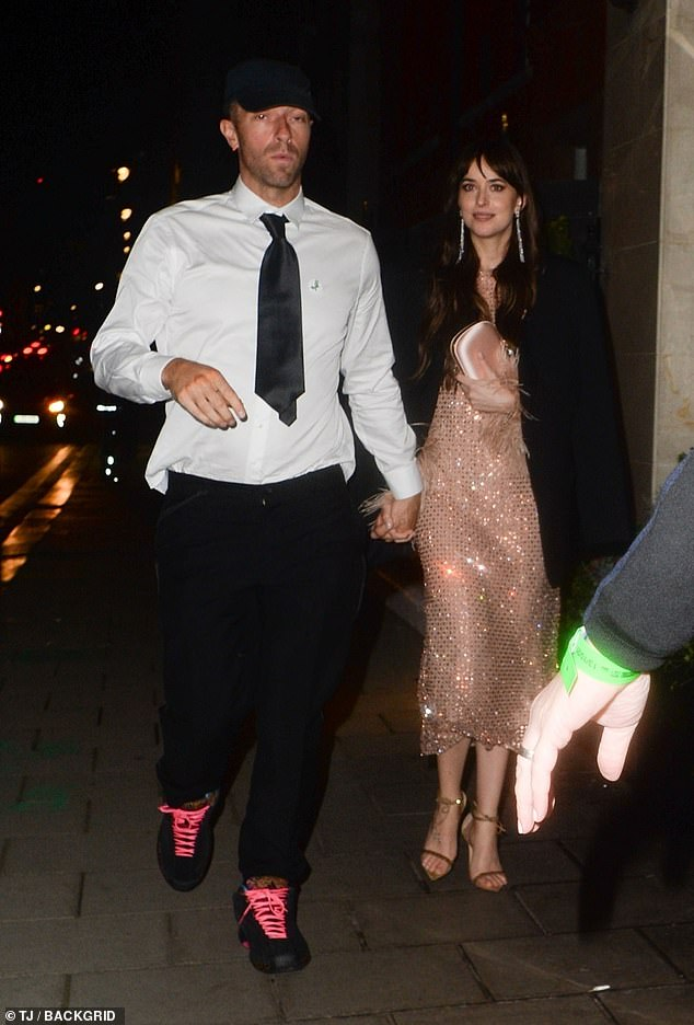 Night out: The 50 Shades Of Grey star, 32, held hands with the Coldplay singer, 44, as they left the event at The Royal Festival Hall and headed back to the Claridge's Hotel
