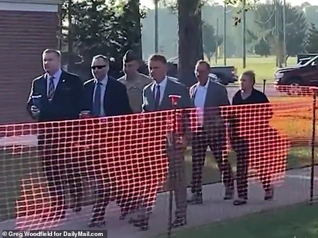 Colonel Stuart Scheller Jr. (seen in uniform) was flanked by his defense team including lawyer Timothy Parlatore as he walked to the courtroom at Camp Lejeune in North Carolina Thursday