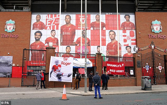 Liverpool fans placed banners on the fence in front of The Kop at Anfield as a tribute
