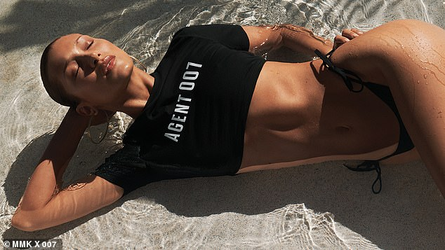 Agent 007:Hadid is cast as a sexy Bond girl as she models crop tops and miniskirts from the new line which coincides with the release of No Time To Die with Daniel Craig, Lea Seydoux and Ana de Armas