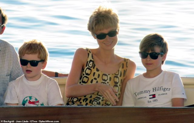 Boasting Diana's signature locks, the actress (pictured centre), who is taking over the role from Emma Corrin, sported dainty golden hoops, similar eye-catching sunglasses to the royal's original pair, and a statement leopard print swimsuit