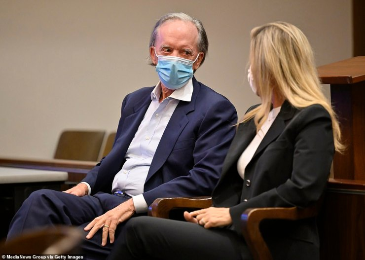 Bill and Amy Gross are seen in court on October 1. A judge found the couple guilty of flouting a court order not to annoy their neighbor by playing the theme song from Gilligan's Island