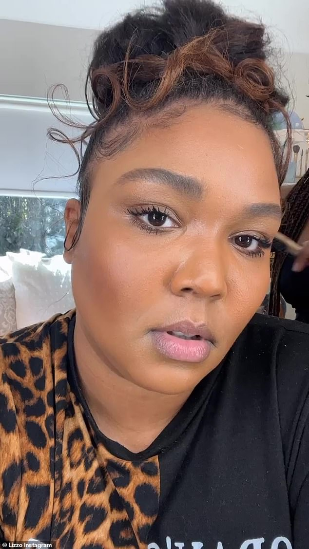 Getting ready:Prior to her date, Lizzo gave her 11.6 million Instagram followers a behind-the-scenes glimpse into her preparation as she filmed her hairstylist perfecting her sky-high hairdo