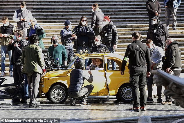 Actors Tom Cruise and Hayley Atwell with the film director Christopher McQuarrie on the set of the film Mission: Impossible 7 in Rome in November 2020. Filming was interrupted due to an on-set outbreak of COVID-19