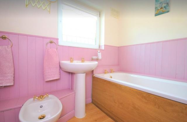 One of the four bathrooms in the main house of the property