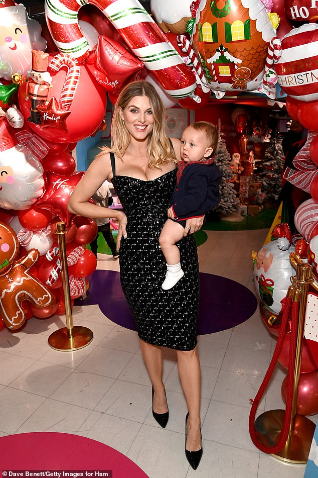 Mom and son: Ashley posed for snaps with her son Alfie, whom she welcomed in early 2021