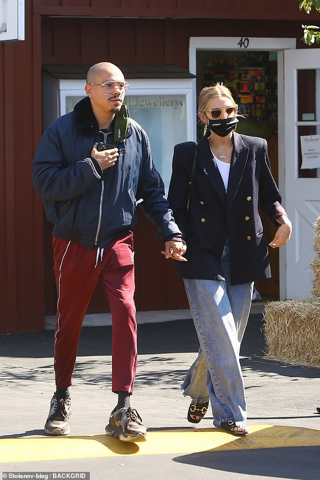 Lovers in LA: Ashlee Simpson proved to be in sync with husband Evan Ross as they stepped out for lunch in Brentwood on Thursday afternoon