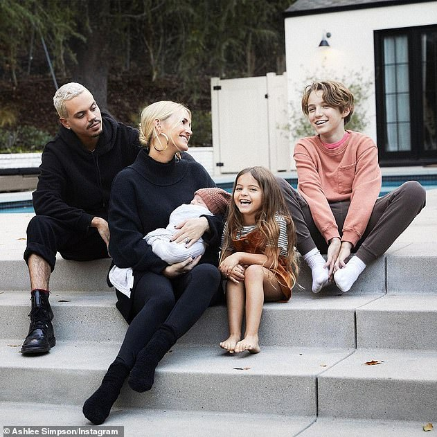 Family forever: Ashley welcomed Ziggy into the world one year ago with her husband of seven-years, Evan Ross