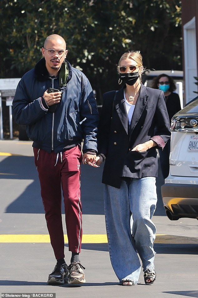 Out and about: The 37-year-old actress rocked an oversized blazer with jeans while her beau sported joggers while leaving the local Country Mart