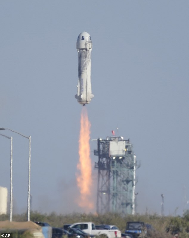 They say the advent of space tourism will help us better understand the vulnerability of the planet (pictured, a rocket carrying William Shatner launches)
