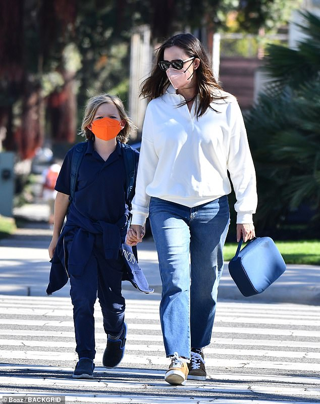 Doting mom: The Miracles From Heaven star held hands with her son Samuel while crossing the street in the nearby Pacific Palisades neighborhood