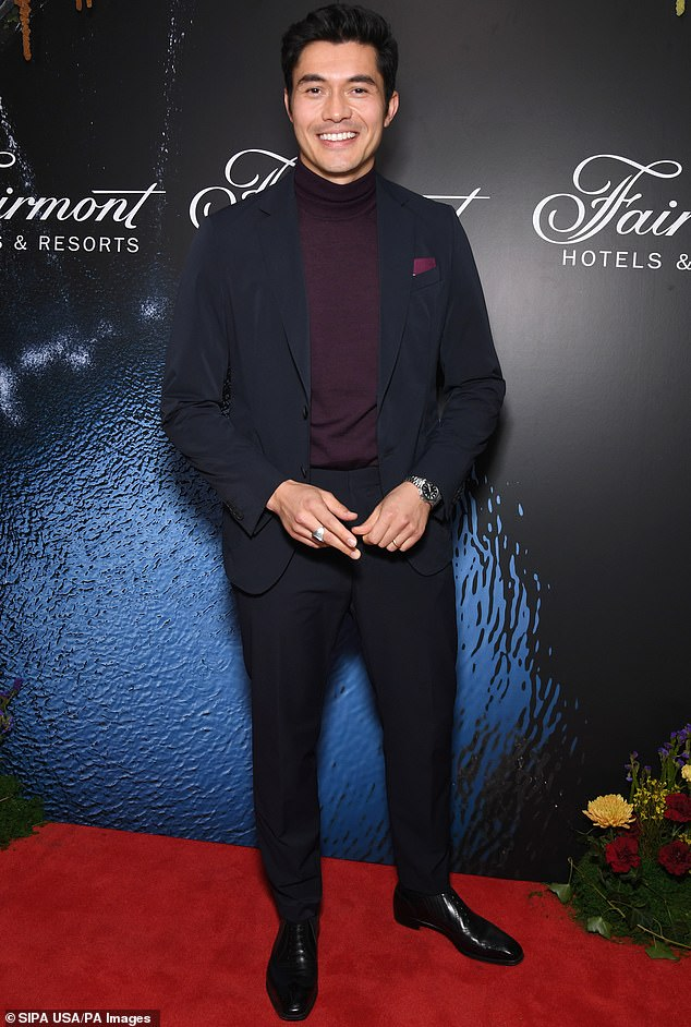 Megawatt smile:Henry Golding was dashing as ever while posing up a storm at an event in front of New York's Plaza Hotel recently