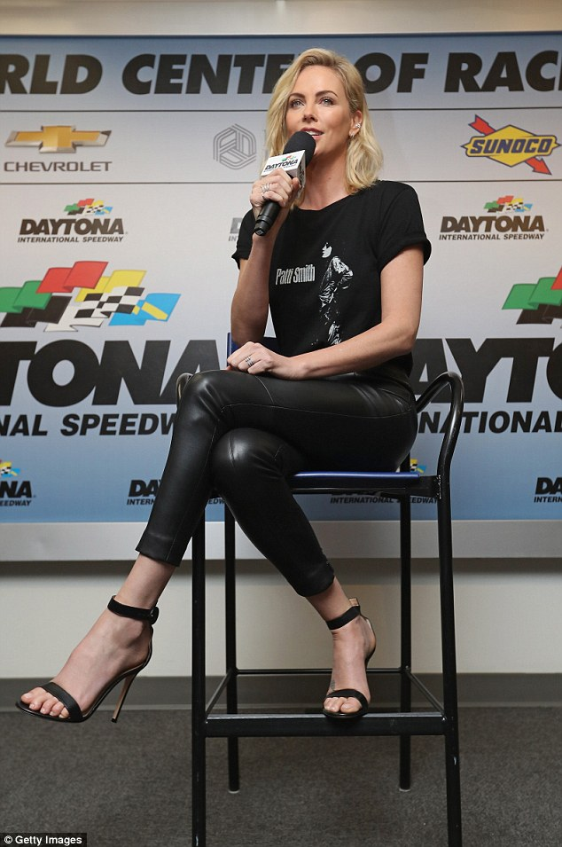 Charlize Theron rocks skintight leather pants at NASCAR | Daily Mail Online