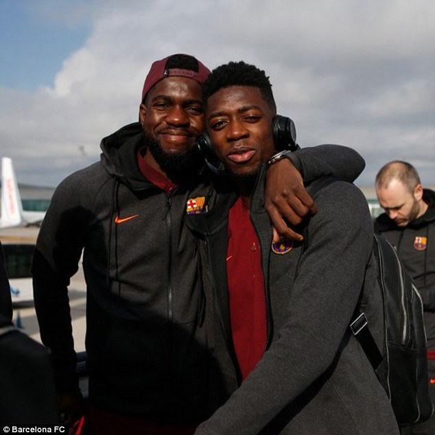Samuel Umtiti (left) and Ousmane Dembele pose for a photo as they prepare to board