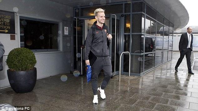 Ivan Rakitic appeared in a joyful mood as he arrived in rainy London on Monday