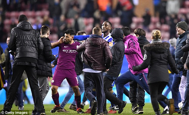 The striker was clearly angry and chased after the fan before City coaching staff intervened