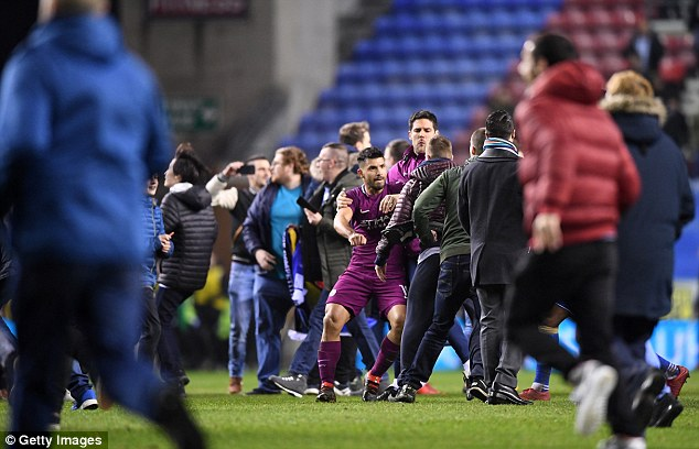 While heading back towards the away dressing room, Aguero reacted furiously to a fan