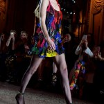 Gigi Hadid rocks a rainbow mini-dress at Milan Fashion Week