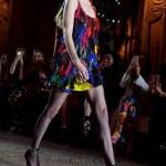 Gigi Hadid rocks a rainbow mini-dress at Milan Fashion Week