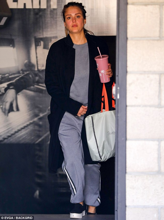 Working on her fitness: Jessica Alba, 36, headed to an LA gym for a workout on Friday