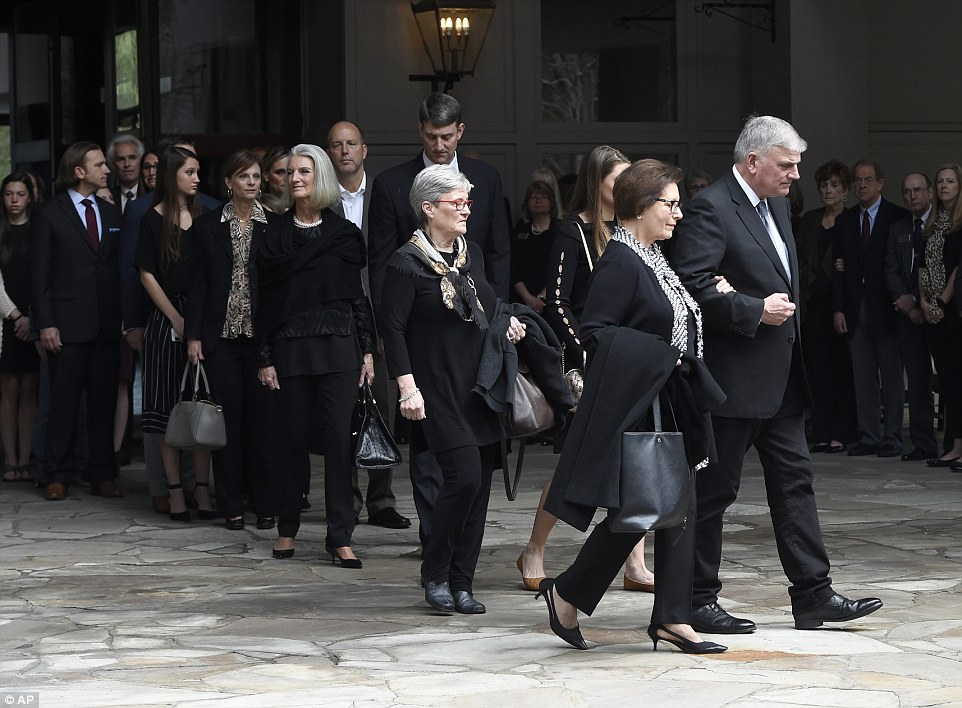 Family members, including Franklin Graham, right, walk to vehicles before the body of Rev. Billy Graham leaves the Billy Graham Training Center at the Cove on Saturday, February 24, 2018