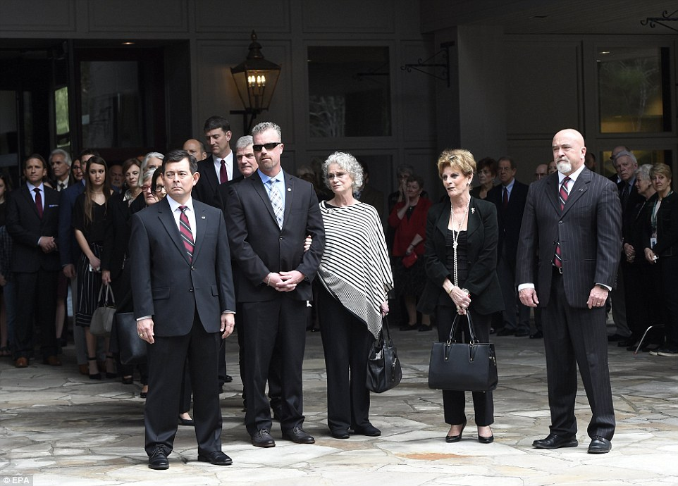 Family members watch as pallbearers carry the body of Rev. Billy Graham to a hearse at the Billy Graham Training Center at the Cove in Asheville