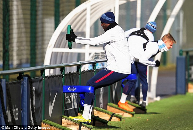 Yaya Toure was among the players using weighted disks to warm up on the sidelines