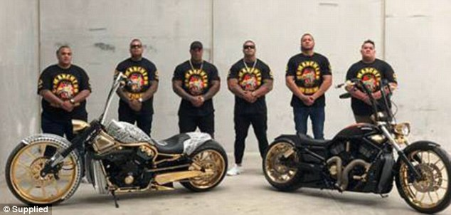 New Zealand Comanchero bikies pose behind two gold-detailed machines for Istagram posts