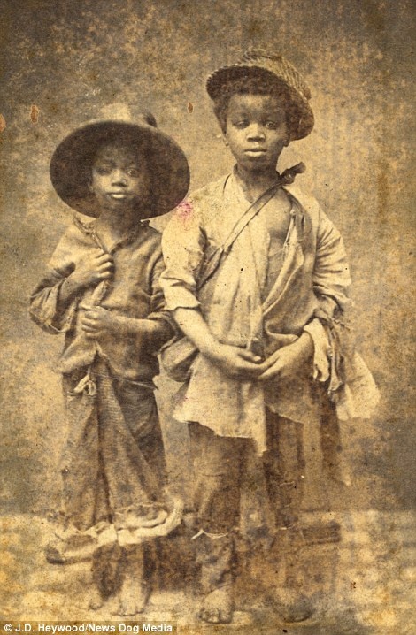 Two African American boys from North Carolina, circa 1864. The two young boys (left) were photographed in New Berne, a city that was captured early on in the Civil War by Union soldiers. The picture was likely taken by a photographer sympathetic to the Union cause and the children would have been born into slavery. The Emancipation Proclamation and the subsequent 13th amendment banning slavery would have changed the course of these boys lives