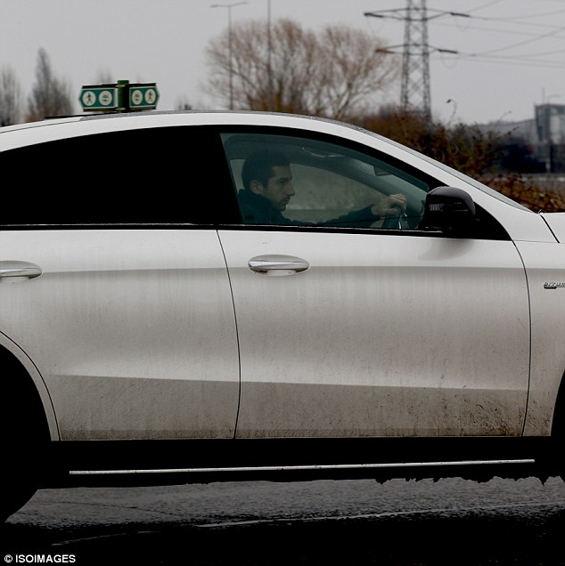 Henrikh Mkhitaryan was seen leaving Arsenal'sLondon Colney training base on Friday