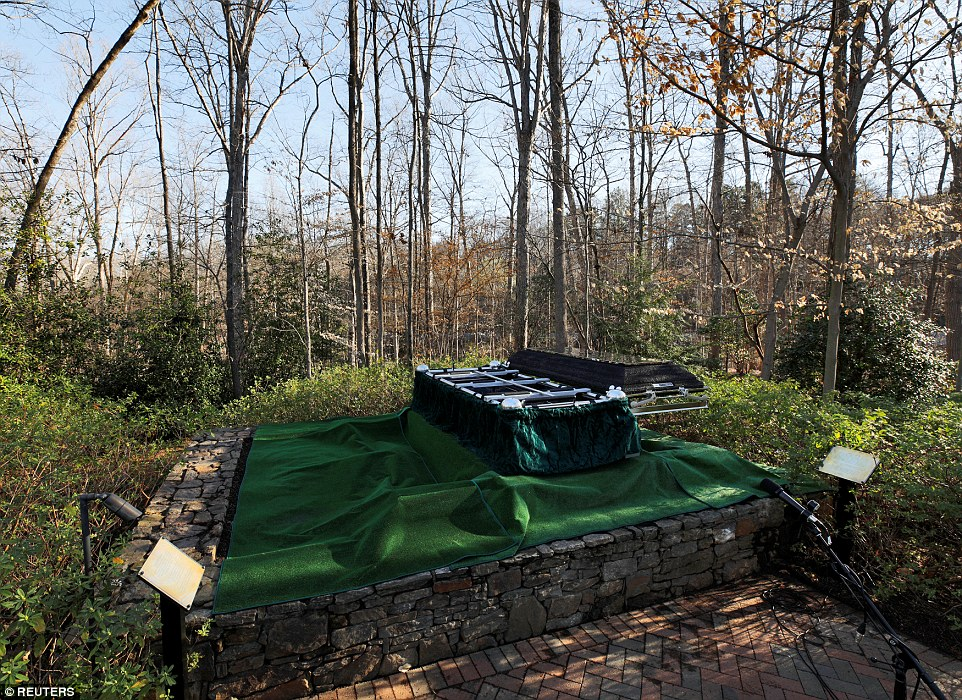 Reunited:The burial site for evangelist Billy Graham which is right next to where his wife Ruth was laid to rest in 2007 (above)