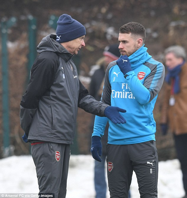 Wenger gives instructions to Aaron Ramsey, who could have a key part to play against Brighton