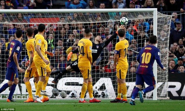 Atletico goalkeeper Jan Oblak is only able to get fingers to the ball as it flies into the top right-hand corner of the net