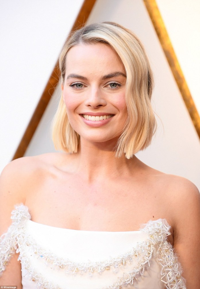 All about the details:She styled her short blonde hair in loose waves; she painted her pout a pink hue with defined brows and a touch of shimmer on her lids