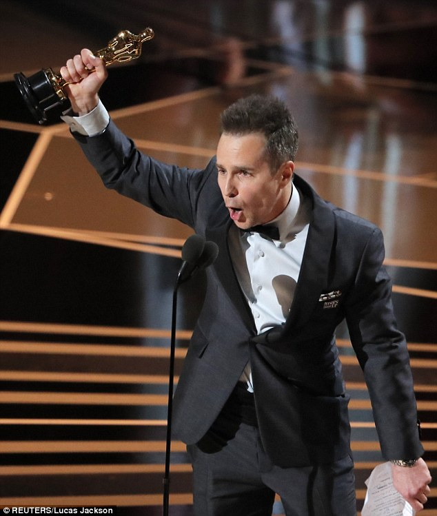 Triumphant: After a 30-year acting career, Sam Rockwell won his first Academy Award on Sunday for best supporting actor, which he dedicated to 'my old buddy Phil Hoffman'