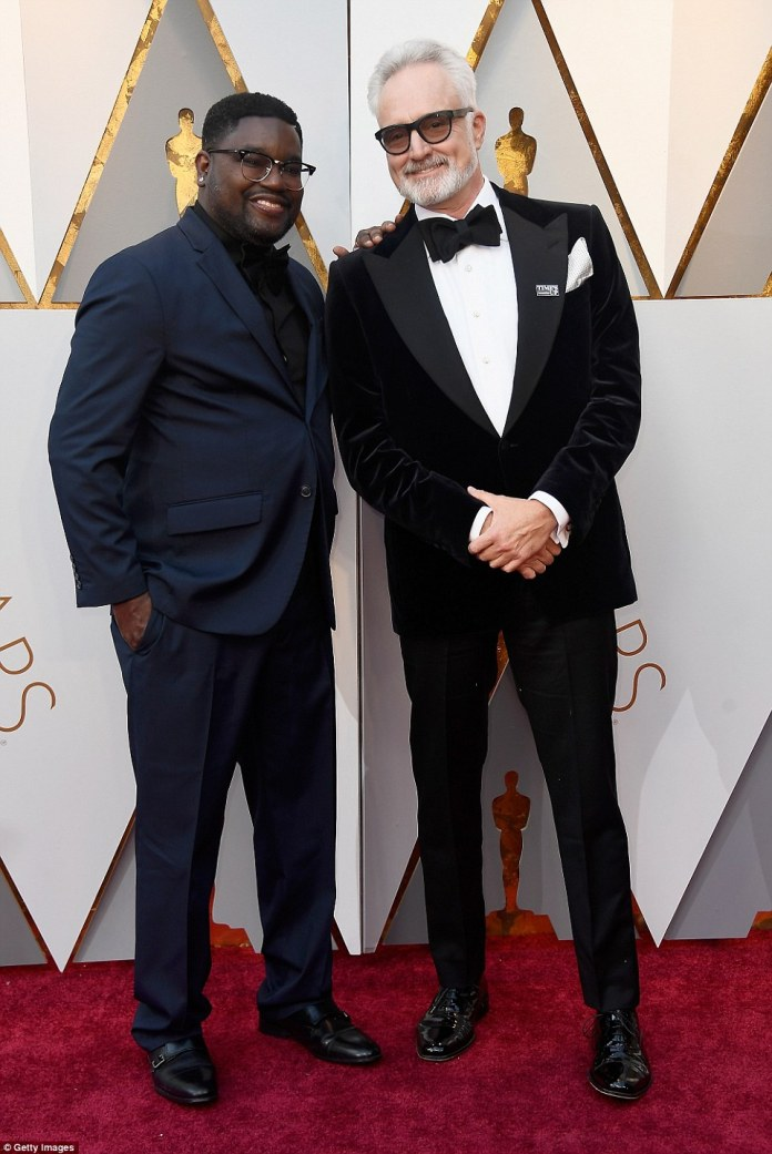 Well dressed: Milton 'Lil Rel' Howery (L) posed on the red carpet with Bradley Whitford